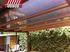 Pergola con techo de policarbonato lacada en marron